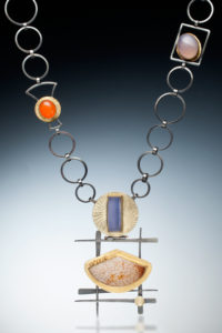 NKL–88: Petrified Palm Wood. Namibian Blue, Orange, Purple Chalcedony, 18k, 24k gold, oxidized sterling silver, 26 inches long. $2400.00. SOLD