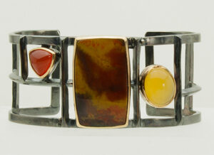"BR–7: Oxidized sterling silver, Agate Orange Chalcedony, Yellow Chalcedony set in 18k gold, 2.50"" ht. size 8.SOLD"