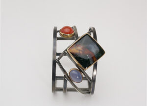 "BR–8: Oxidized sterling silver, Morrisonite, Orange Chalcedony, Nebiam Blue Chalcedony, 2.50"" ht. size 7.50. $1600.00 [add_to_cart id=""779""]"