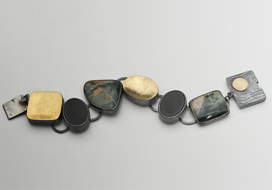 BR-5-Imperial Jasper, Black Onyx, 18k gold, oxidized sterling silver. 1.0 inch wide. Size 7.50 long.