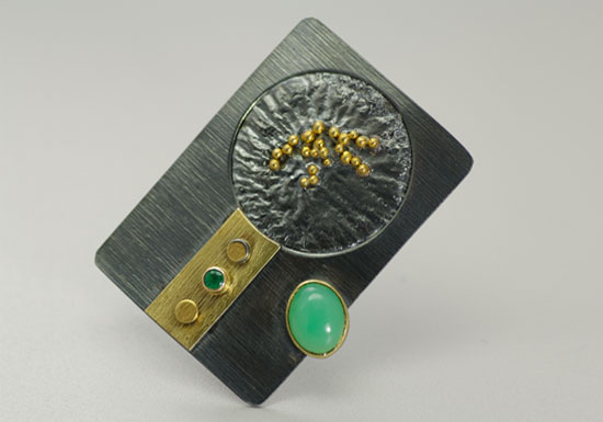 BRPN–2: Oxidized reticulated silver, 22k, 18k gold, tsavorite, chrysoprase. Brooch may be worn as a pendant. 1.75 inches long by 1.25 inches wide. SOLD