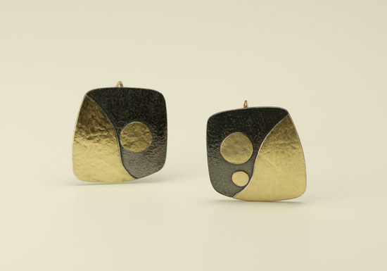 ER–18: Oxidized sterling silver, 14k, 18k gold on silver, 1.0 inch wide by 1.25 inch long.
