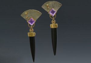 ER–2: Black onyx, amethyst, sterling silver, 14k, 18k gold, 2.5 inches long. SOLD