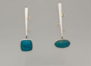 ER–33: Sterling silver, 14k gold, chrysocolla, 2 inches long.