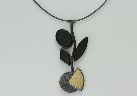 NKL-4- Oxidized silver, 18k gold on silver, 14k gold, peridot black onyx, 18 inch chain, pendant 3.50 inches by 1.50 inches.
