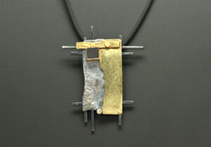 NKL–18: Oxidized silver, 14K, 18k gold, black onyx, 2.0mm diamond 3inches x 2.5 inches, 22in rubber cord. SOLD
