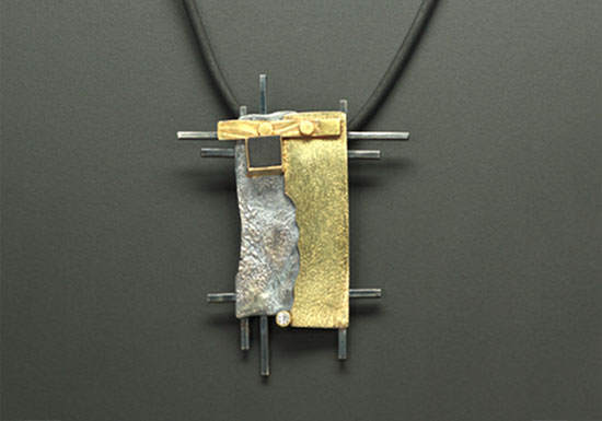 NKL-18- Oxidized silver, 14K, 18k gold, black onyx, 2.0mm diamond 3inches x 2.5 inches, 22in rubber cord. SOLD