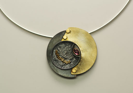 NKL–5: Oxidized reticulated silver, 22k, 18k gold on silver, tourmaline. Pendant 1.75 inches by 1.75 inches. 16 inch omega chain included. 18 inch chain available for an additional cost per market. SOLD