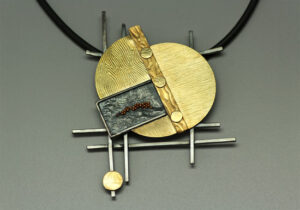NKL–20: Reticulated oxidized silver with 18k gold granulation, 18K gold, 20 inch rubber cord, 3.35 inches by 3.0 inches. SOLD