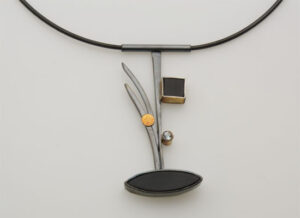 NKL–21: Oxidized sterling silver, black onyx, 14k gold, 20 inch cable, pendant 3 inches long.