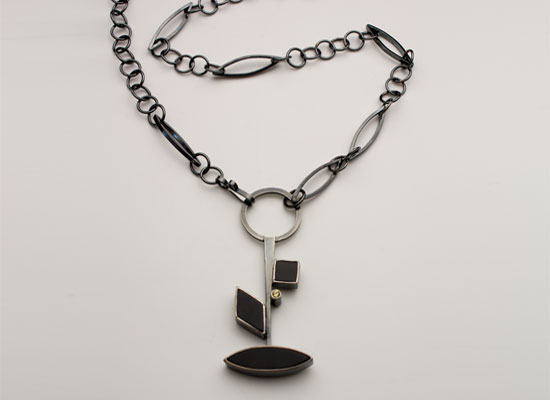 NKL-25-Oxidized sterling silver, yellow sapphire, pendant 4.0 inches by 1.25 inch, chain 24 inches.