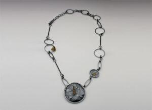 NKL–26: Oxidized reticulated silver, 18k gold granulation, pendant 2.75 inches by 2.75 inches, chain 26 inches.