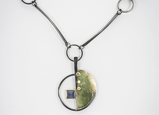 "NKL–55: Oxidized sterling silver, 18k gold, Blue Chalcedony, 22"" chain. SOLD"
