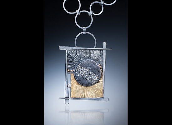 NK–59: Natural Pyrite in slate. Hand forged oxidized reticulated silver, embossed 22-karat gold on silver bimetal, 22-karat gold fused balls, 0.06 ct Harmony diamond set in 18 karat gold bezel. Pendant 2.5 x 1.75 inches, chain 20 inches.