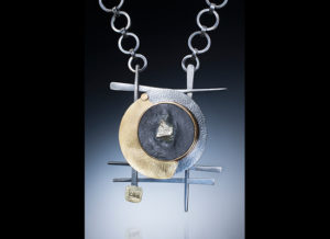 NKL-60- Natural Pyrite in slate. Hand forged oxidized silver, embossed 22-karat gold on silver bimetal, 18-karat gold bezel, Pendant 2.5 x 1.75 inches, chain 20 inches.