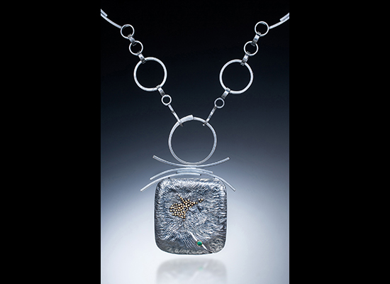 NKL–65: Reticulated oxidized silver with 2.5mm emerald, 22K gold granulation, 24 inch chain, pendant 2.75 X 2.50 inches.