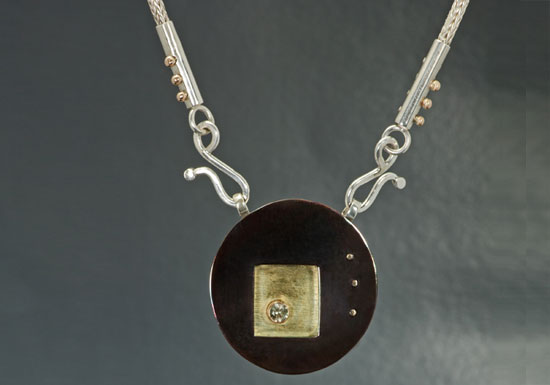 NKL–7: Shakudo, 18k gold, sterling silver, green tourmaline necklace, 20 inches fox-tail chain pendant.