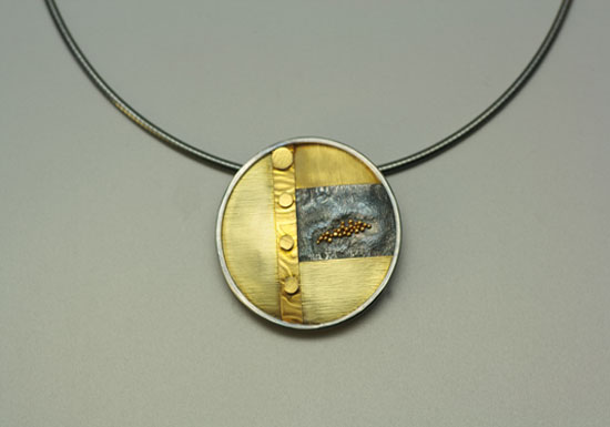 NKL–8: Oxidized reticulated silver, 22k, 18k gold, on 16 inch omega chain, pendant.