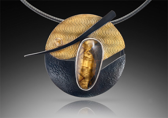 NKL–28: Embossed oxidized silver and 18k gold, tigar's eye, yellow 3.0mm sapphire, 18 inches omega chain with hand fabricated clasp. SOLD