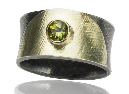 """R–18: Peridot 5mm set in 18k gold, with 22k gold on oxidized sterling silver.Size 7.25. $500.00 [add_to_cart id=""""765""""]"""
