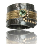 """R–19: Green Tourmaline 4mm set in 18k gold, 22k gold on oxidized silver with 22k gold fused balls.Size 6.25. $950.00 [add_to_cart id=""""766""""]"""