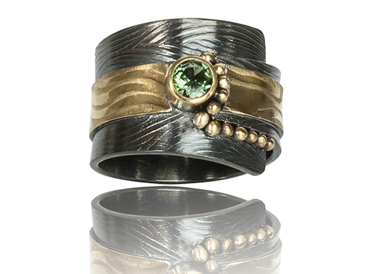 "R–19: Green Tourmaline 4mm set in 18k gold, 22k gold on oxidized silver with 22k gold fused balls.Size 6.25. $950.00 [add_to_cart id=""766""]"