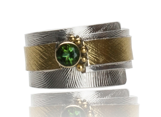 R–22: Green Tourmaline, sterling silver 18,22k gold. Size 7.25. Sold