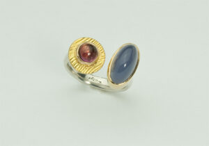 R–6: Blue Chalcedony, Pink Tourmaline, 18k gold, sterling silver. Size 7.50.