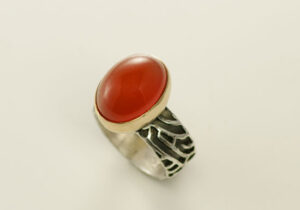RG–2: Oxidized, polished silver, 18k, carnelian, 7.0 band ring. Ring shank 7/16th height. SOLD