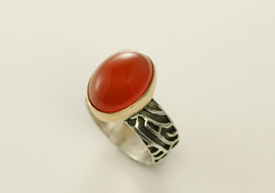 RG-2-Oxidized, polished silver, 18k, carnelian, 7.0 band ring. Ring shank 7/16th height. SOLD